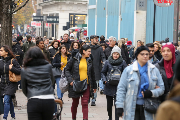 Shoppers are seen walking past forever 21, Black Friday 2018