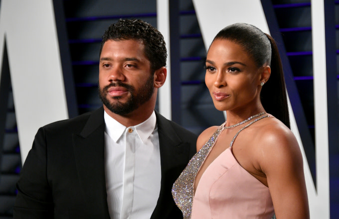 Russell Wilson (L) and Ciara
