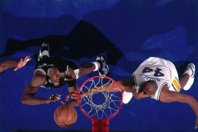 David Robinson of the San Antonio Spurs and Clifford Rozier of the Golden State Warriors circa 1996