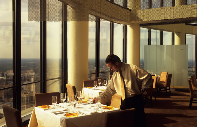 A Waiter setting a table.