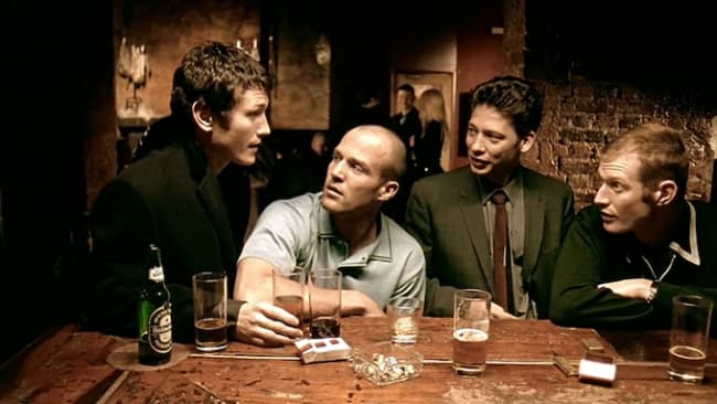Statham at a bar table movie scene