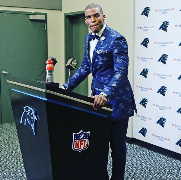 Cam Newton Wearing a Camo Suit