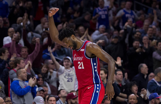 Joel Embiid invites the crowd to make some noise.