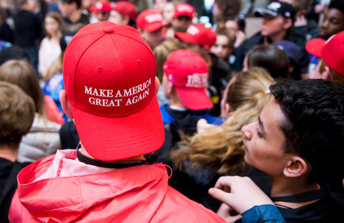 Students touring Congress in MAGA hat