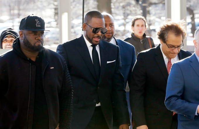 Singer R. Kelly (C) arrives for his court date