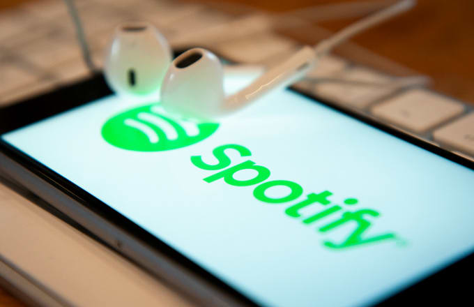A phone with a Spotify music application