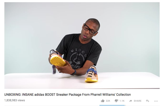 huge selection of 2d6fd 08bd0 Jacques Slade, aka Kustoo, unboxing a pair of Pharrell s Adidas sneakers.  Image via YouTube. ""