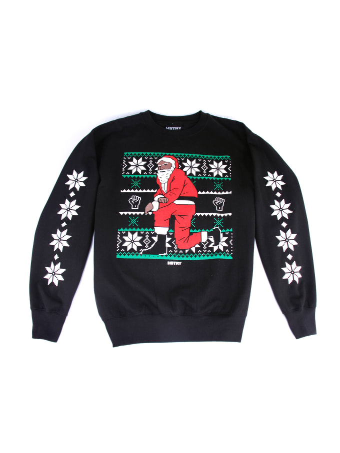 Nas Releases a Collection of Kneeling Santa Christmas Sweaters | Complex