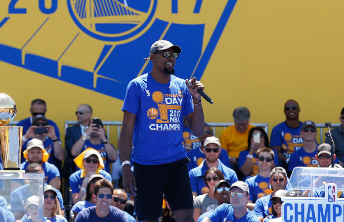 Kevin Durant takes the stage during the Warriors' championship celebration.