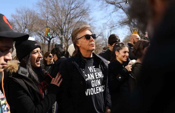 Sir Paul McCartney joins thousands of people, many of them students, march against gun violence.