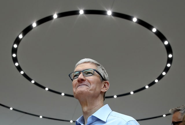 Apple CEO Tim Cook looks on during an Apple special event at the Steve Jobs Theatre