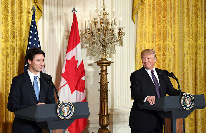 Donald Trump (R) attends a joint press conference with Justin Trudeau