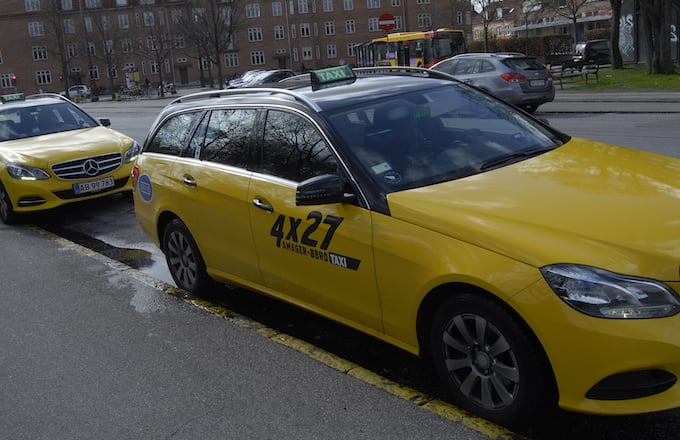 A yellow and black danish taxi