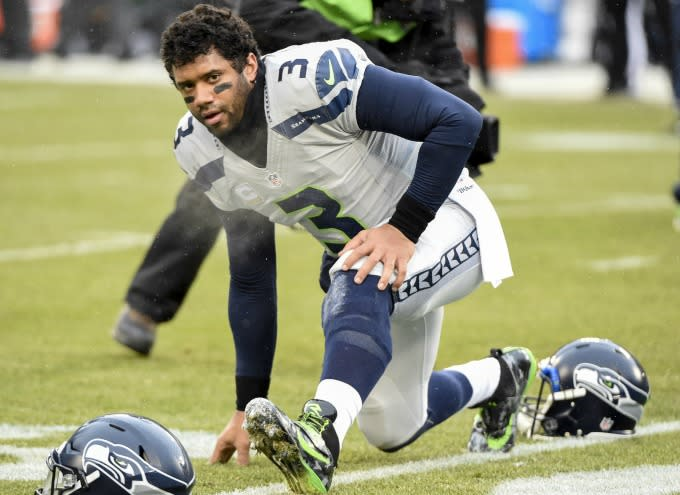 Russell Wilson warms up before a game.