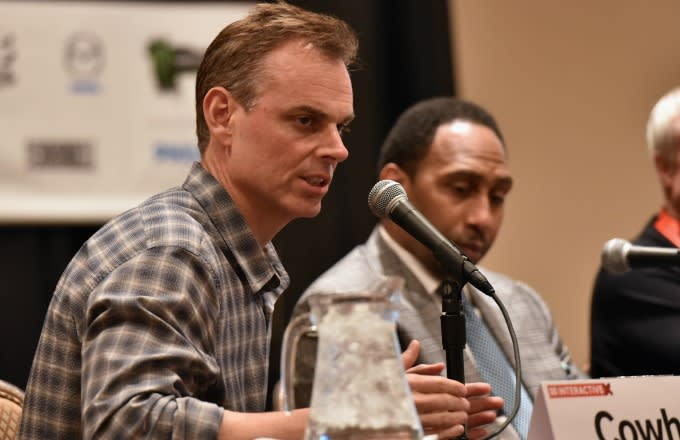 Colin Cowherd speaks on a panel.