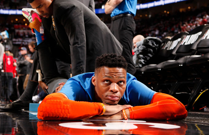quality design 663dd f02e3 Russell Westbrook stretches before a 2019 playoff game.