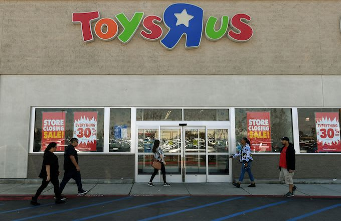 Customers shop at a Toys 'R' Us store.