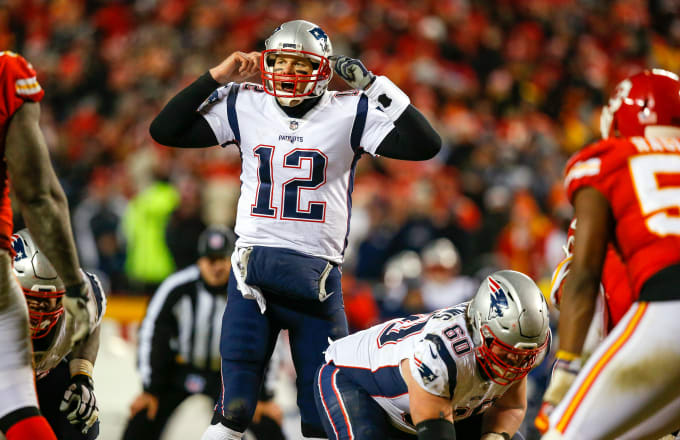 Quarterback Tom Brady #12 of the New England Patriots calls signals in overtime