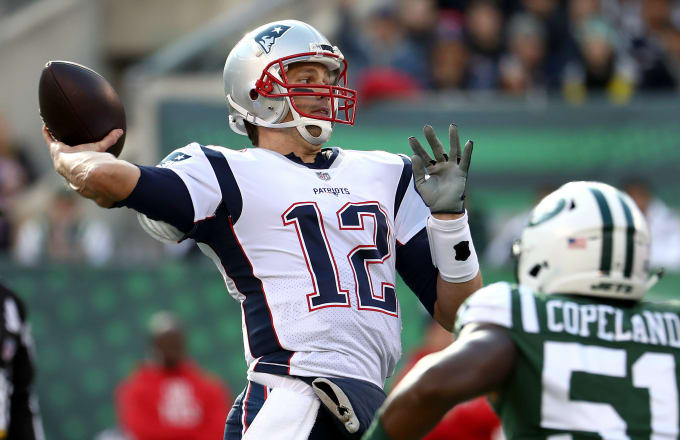 Tom Brady #12 of the New England Patriots looks to pass during the first quarter