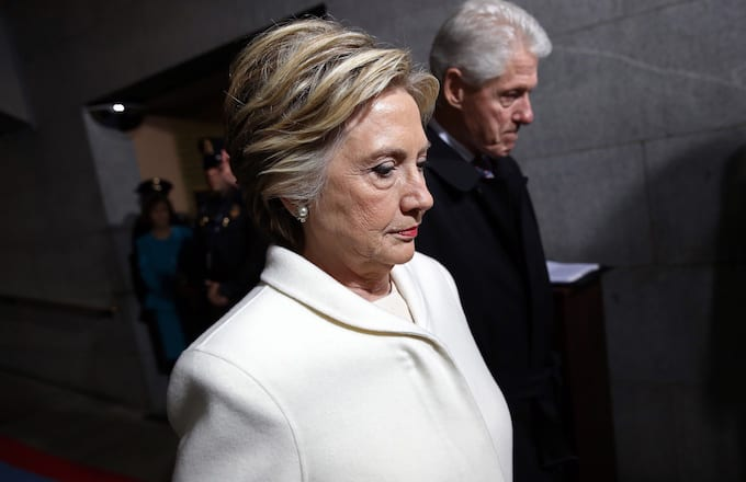Hillary Clinton and Bill Clinton arrive for inauguration ceremony.