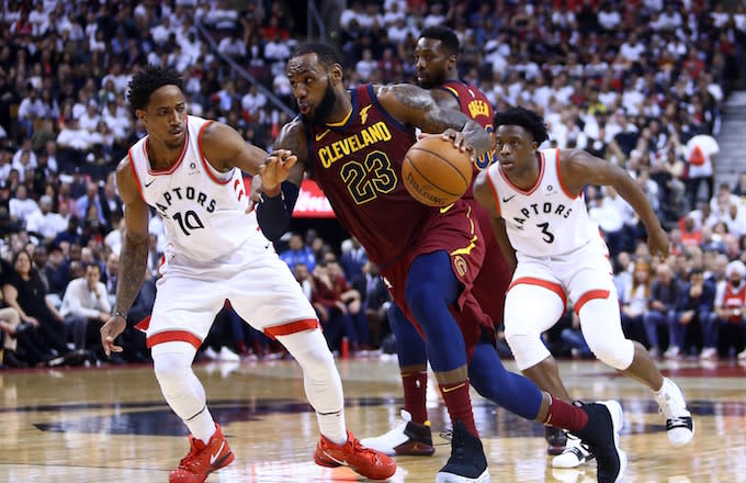 Cleveland Cavaliers dribbles the ball as DeMar DeRozan defends.