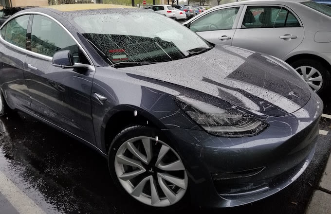 Close-up of Tesla Model 3 electric car from Tesla Motors on a rainy day in Dublin, California.