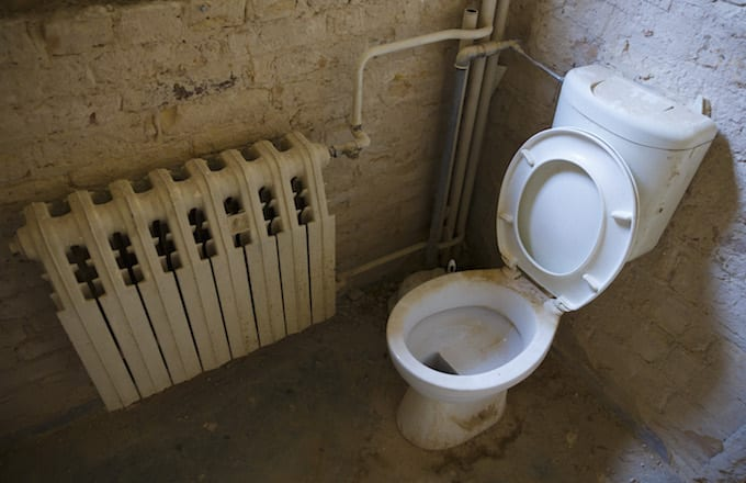 Photo of a dirty and dusty toilet