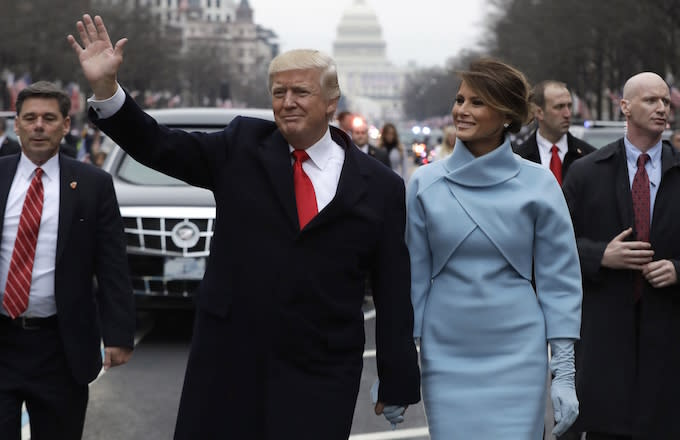Donald and Melania Trump acknowledge the relatively small crowd at his inauguration.