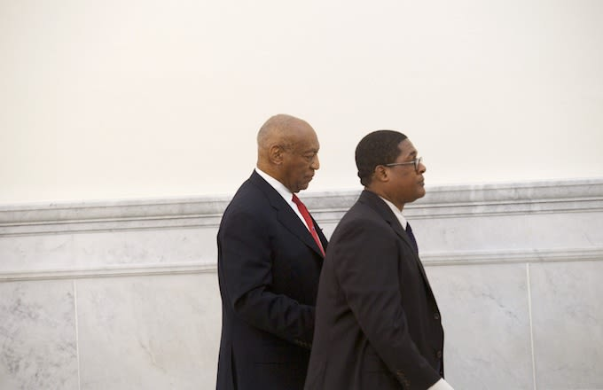 Bill Cosby walks with his publicist, Andrew Wyatt, after being found guilty.