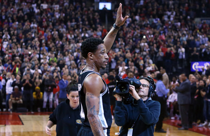 DeMar DeRozan waves to the Toronto crowd in his first game back.