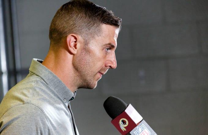 Quarterback Alex Smith #11 of the Washington Redskins addresses the media