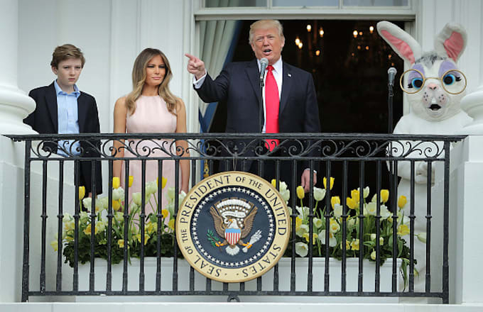 Donald Trump (C) delivers remarks from the Truman Balcony
