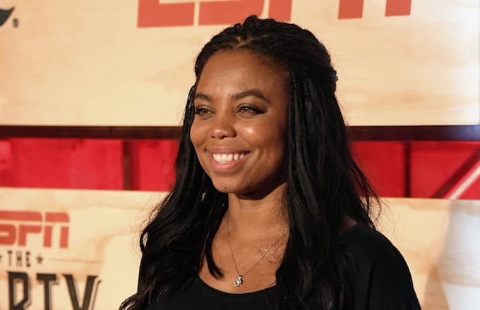Jemele Hill poses for a photo on the red carpet at the ESPN the Party event.