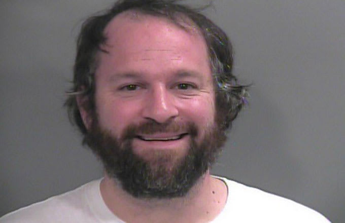 Arkansas professor Lawton Nalley's mugshot after he was arrested for yelling at Bret Bielema.