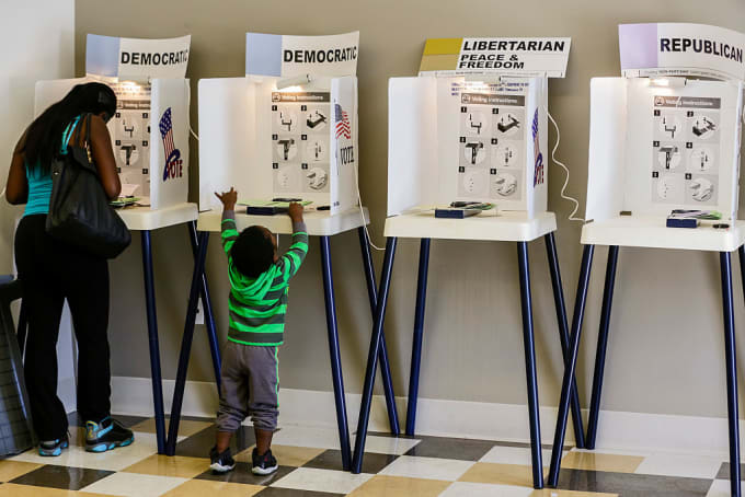Mother and child at voting booths