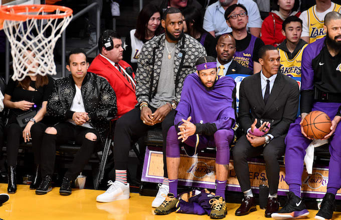 LeBron James on bench in street clothes