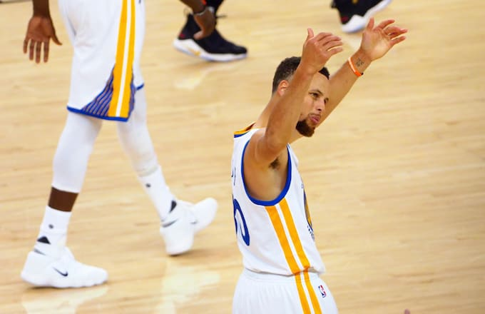 Steph Curry motions to crowd.