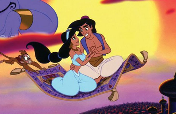 Aladdin and Jasmine riding a magic carpet in the Disney cartoon version of the tale.