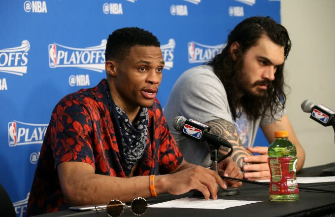 Russell Westbrook speaks at a press conference alongside Steven Adams.
