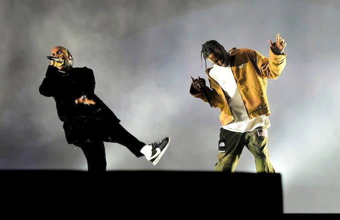 Rappers Kendrick Lamar (L) and Travis Scott.