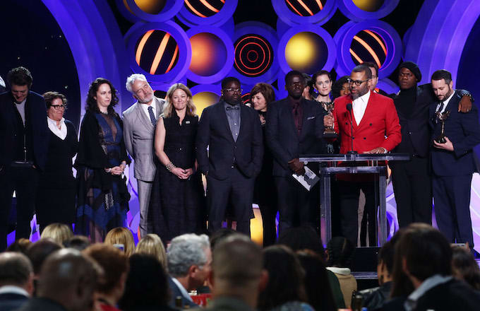Jordan Peele with cast/crew accepts Best Feature for 'Get Out' onstage.