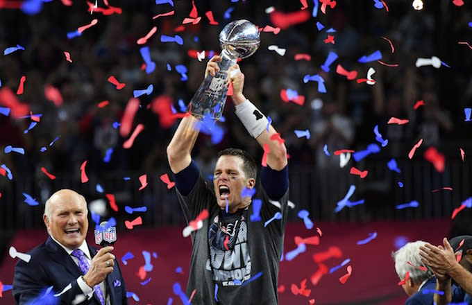 90f41704ecb Tom Brady raises Lombardi Trophy following Patriots  Super Bowl LI victory.