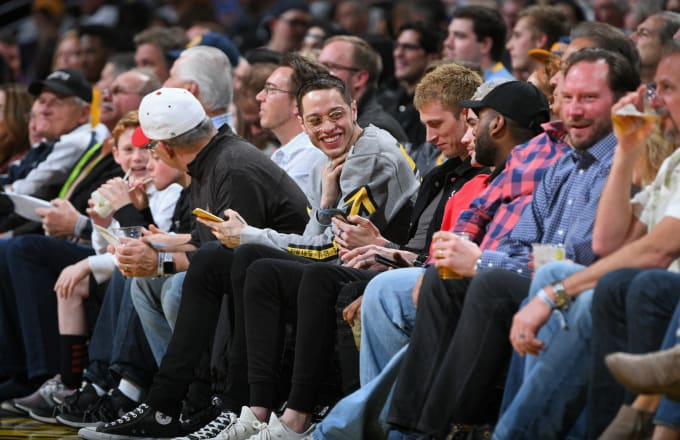 Pete Davidson, and Machine Gun Kelly is seen at the game