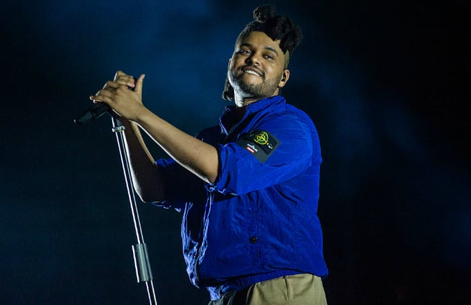 This is a photo of The Weeknd performing.