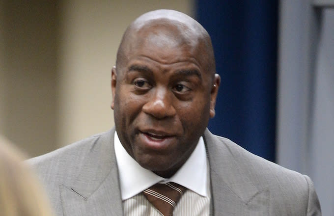 Magic Johnson visits event.