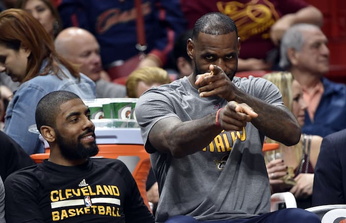 LeBron James points to camera.