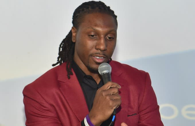 Roddy White speaks at a promotional event.