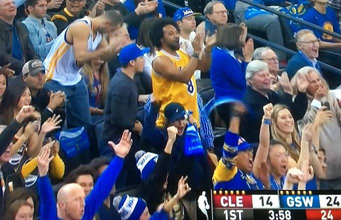 2538f10d8cdb Bandwagon Warriors Fan Celebrates in a Kobe Bryant Jersey