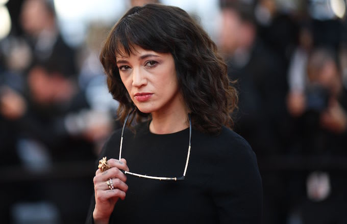 Asia Argento poses as she arrives for the screening of the film 'The Man Who Killed Don Quixote.'