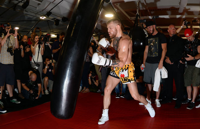 Conor McGregor works out in front of a crowd of media on August 11.